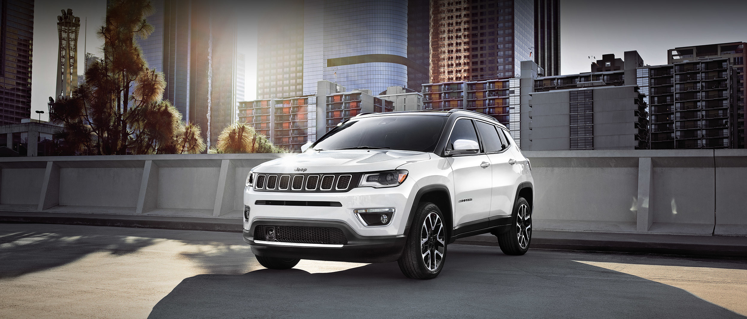 2019 Jeep Compass silver driving