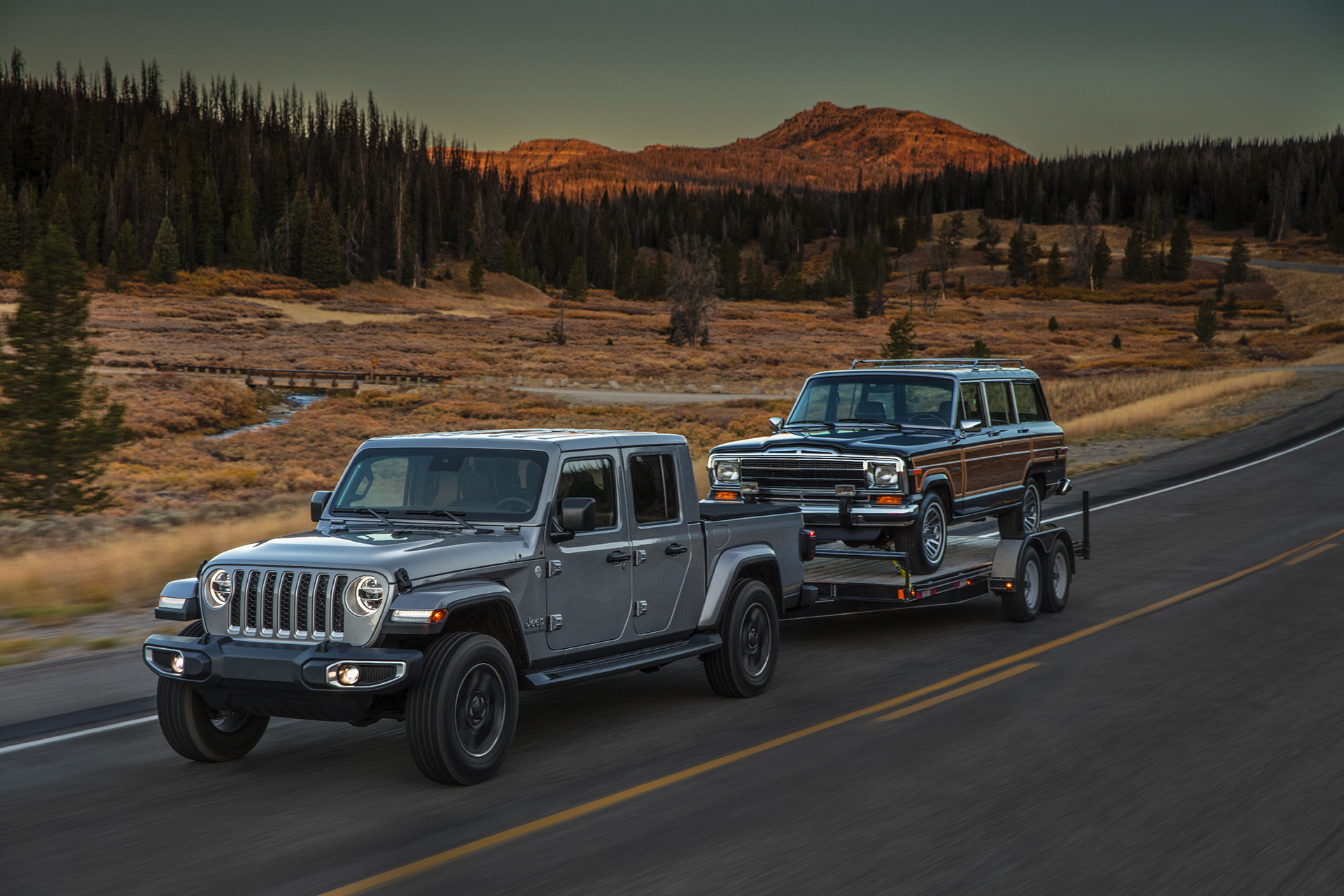 2020 Jeep Gladiator exterior in grey shown towing a car.