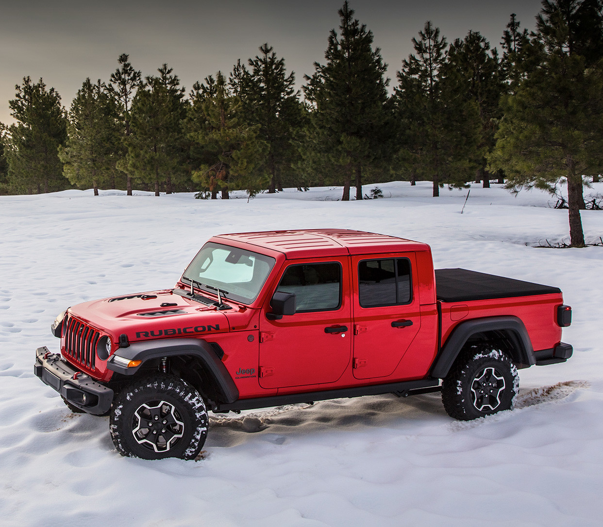 Top-down view of the all-new 2020 Jeep Gladiator in red parked in a snow covered field