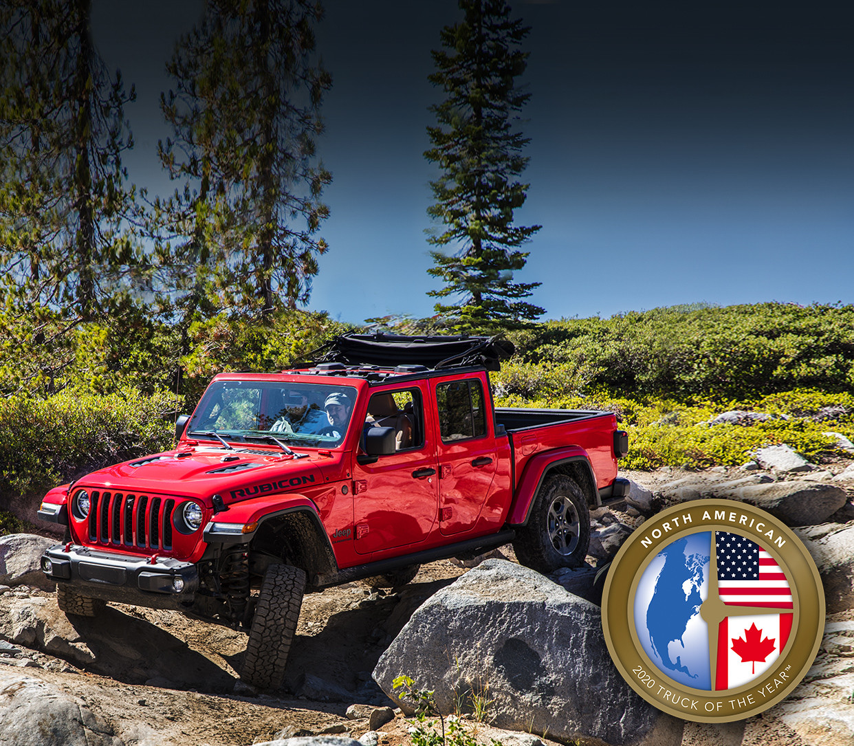 Red 2020 Jeep Gladiator being driven through an extremely rocky terrain.