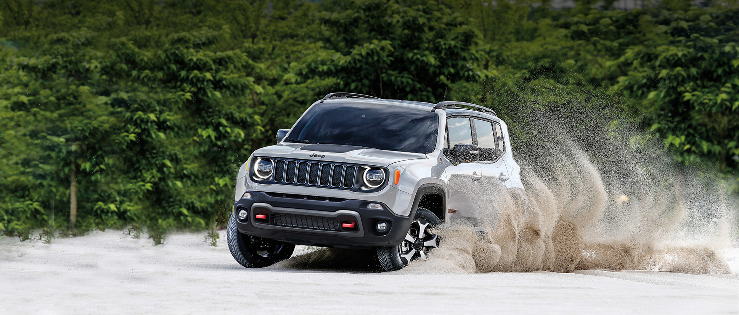 2019 Jeep Renegade silver exterior driving through sand