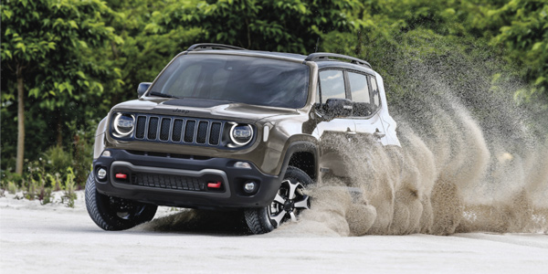 Grey 2020 Jeep Renegade driving through sand using 4x4 capabilities
