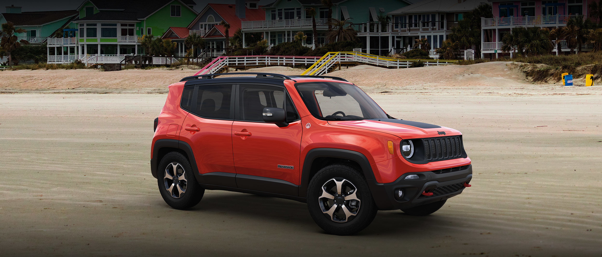 Front three quarter view of 2020 Jeep Renegade parked outside in a city
