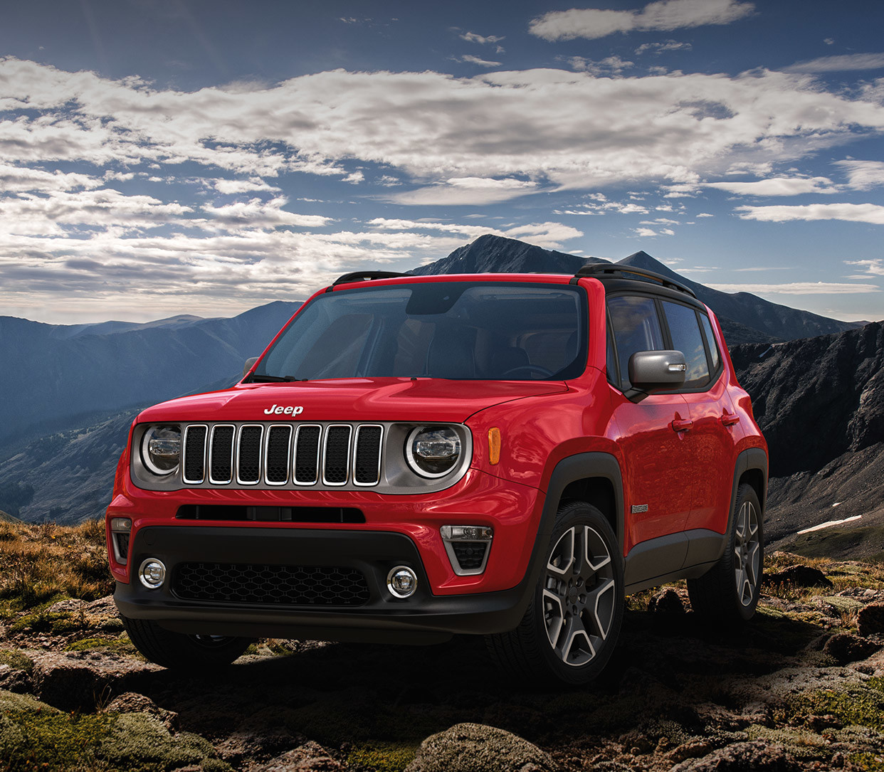 Front view of 2020 Jeep Renegade parked outdoors by mountains