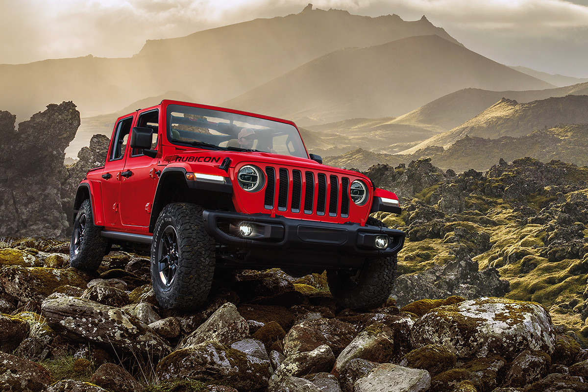 2019 Jeep Wrangler off-roading over rocks, shown in red