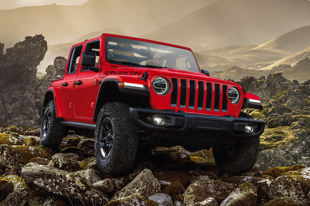 2019 Jeep Wrangler on road, shown in red
