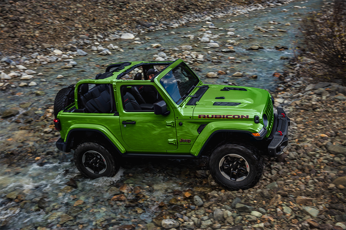 2019 Jeep Wrangler side view on mountain, shown in red