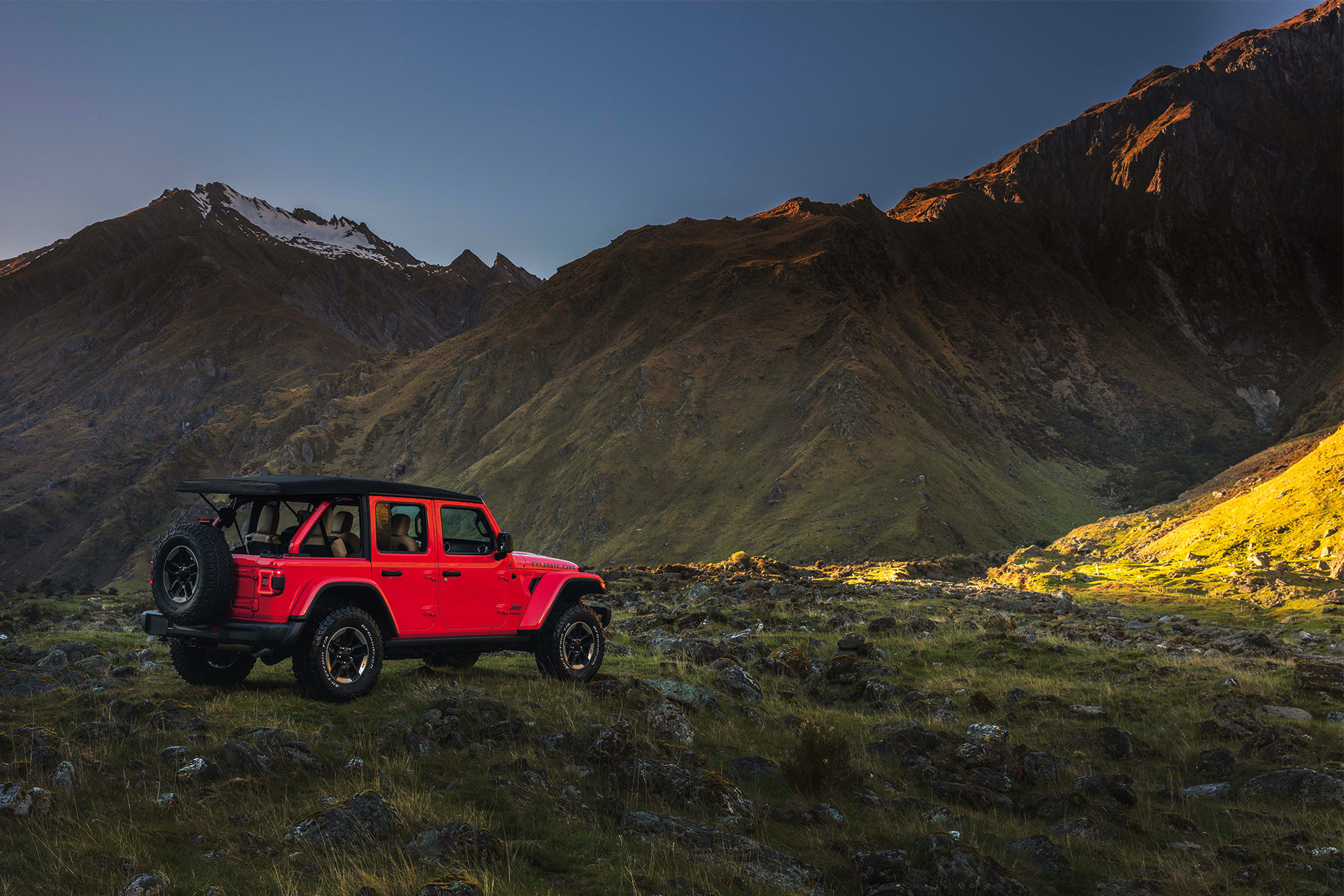 2019 Jeep Wrangler parked on mountain, shown in red