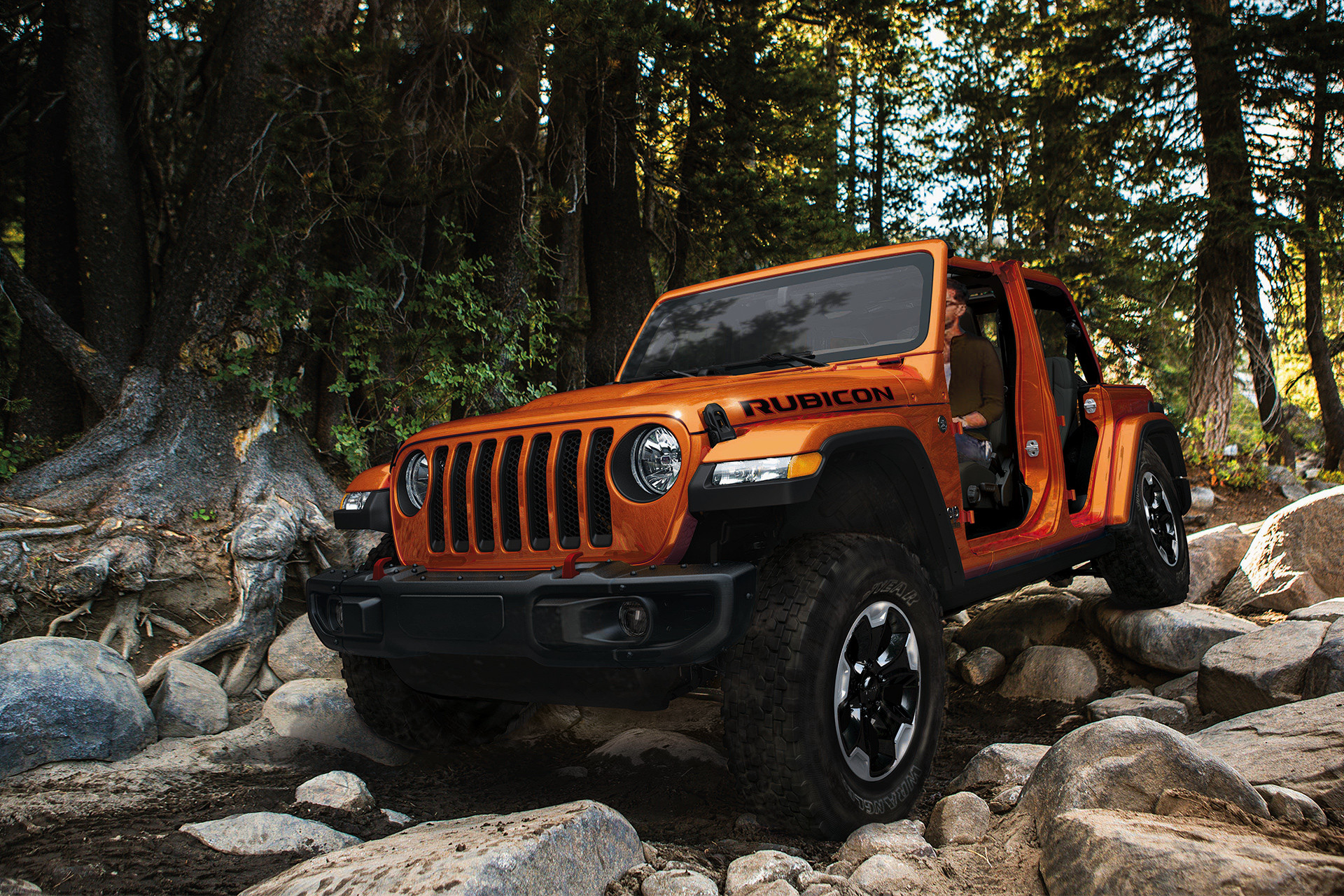 2019 Jeep Wrangler Rubicon off-roading, shown in orange
