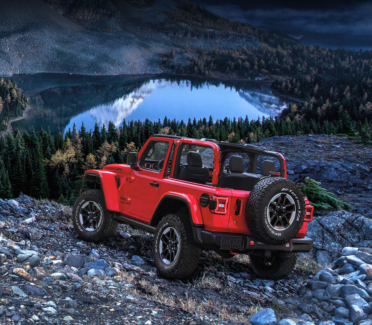 2019 Jeep Wrangler on river bed, shown in red
