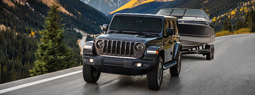 2019 Jeep Wrangler on sand dune, shown in grey