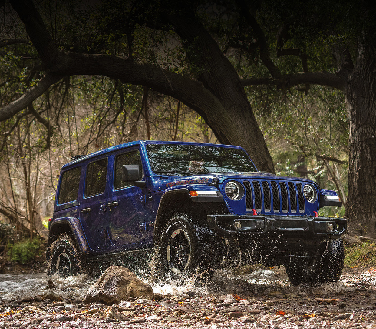 2020 jeep wrangler mobile hero blue driving mud forest 36056efb041b2563342a52a0b6cbb159