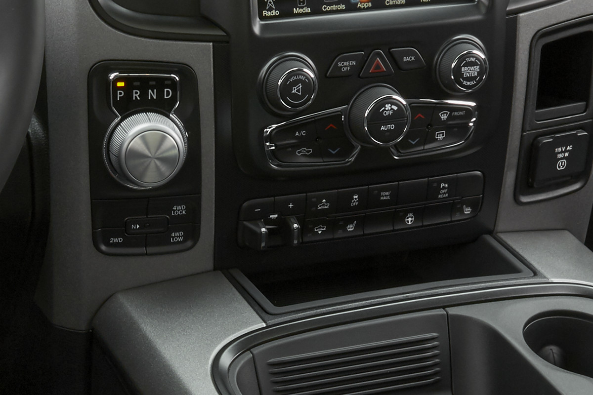 2018 RAM 1500 interior features electronic rotary dial shifter
