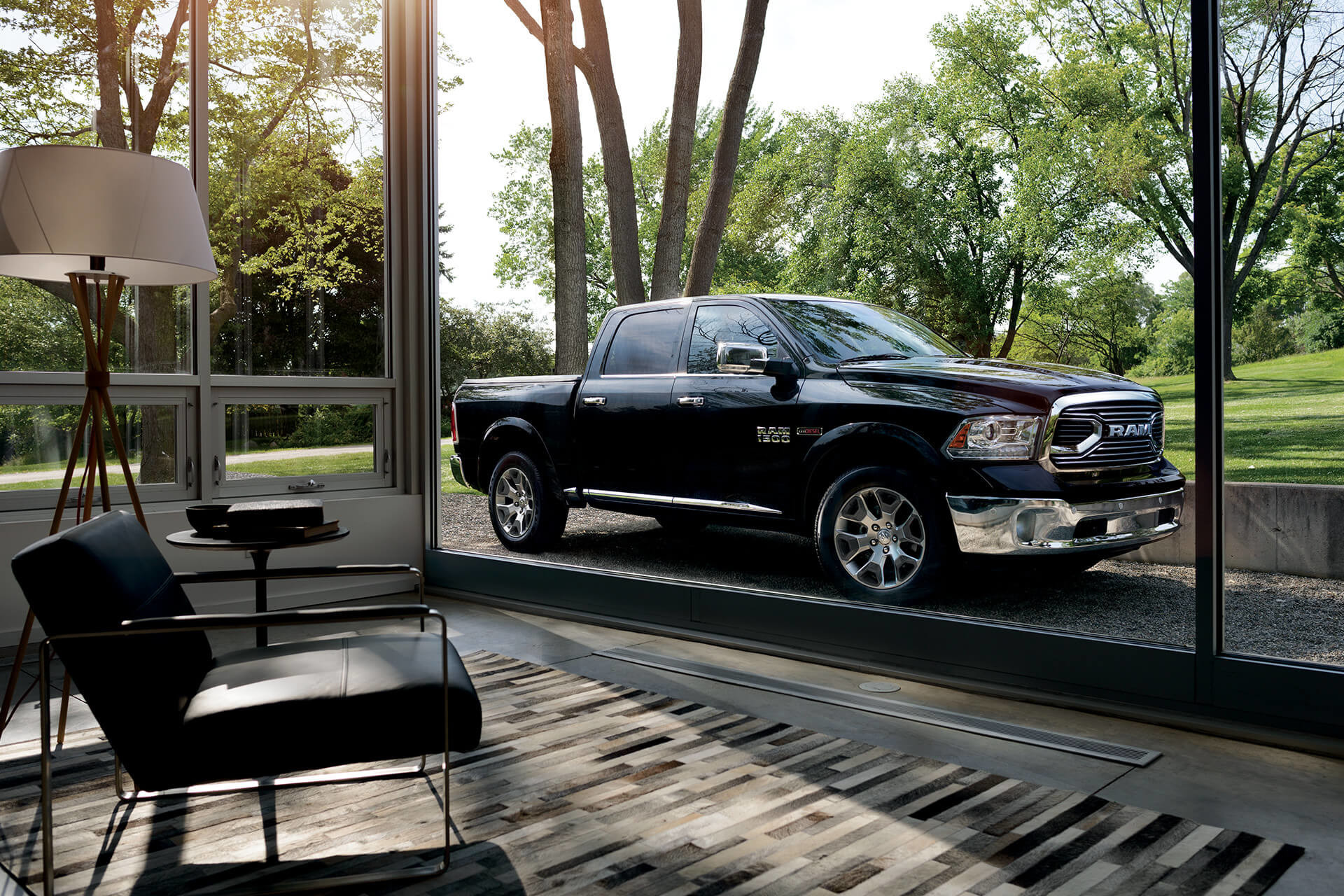 2018 RAM 1500 exterior side view shown in black