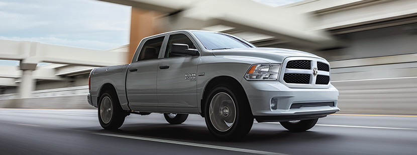 White Ram 1500 DS Driving Down the Road