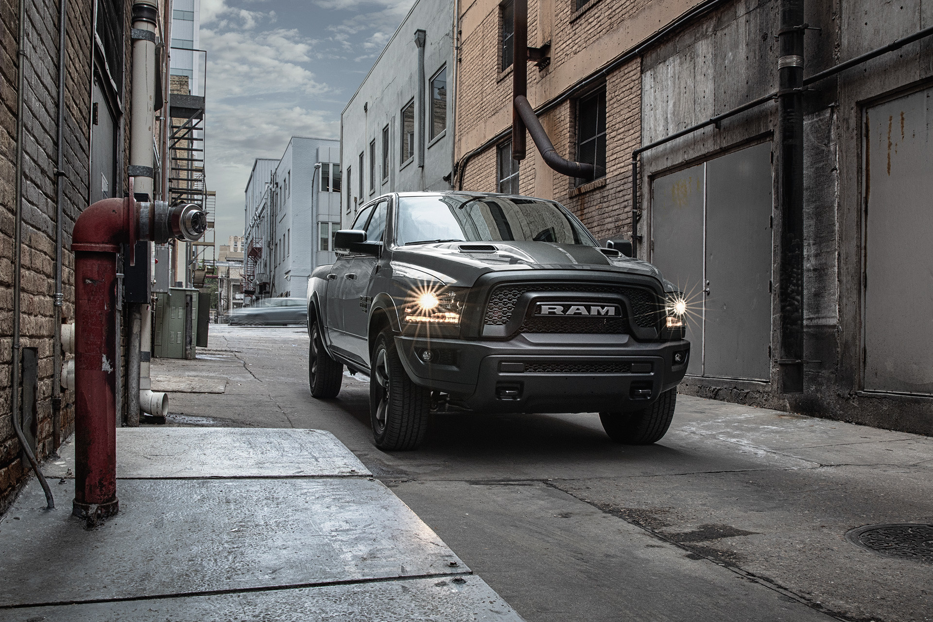 Front view of the grey 2020 Ram 1500 Classic Warlock parked in an alley