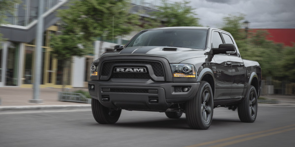 Grey 2021 Ram 1500 DS being driven fast on the road