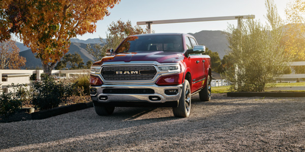 Red 2021 Ram 1500 DT being driven on a pebbled surface