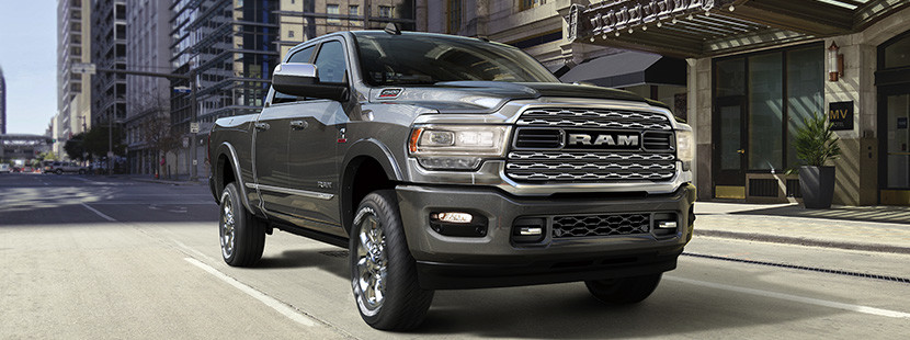 Front quarter view of the New 2019 Ram 2500 in steel metalic colour being driven on a city street