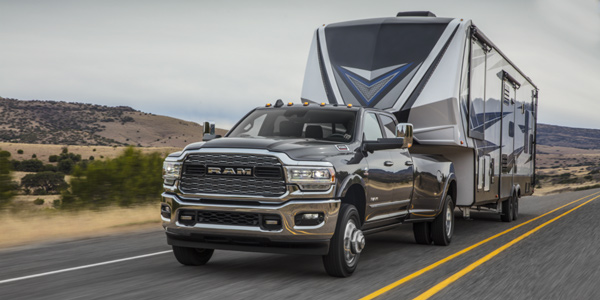 Black 2021 Ram 3500 towing a trailer