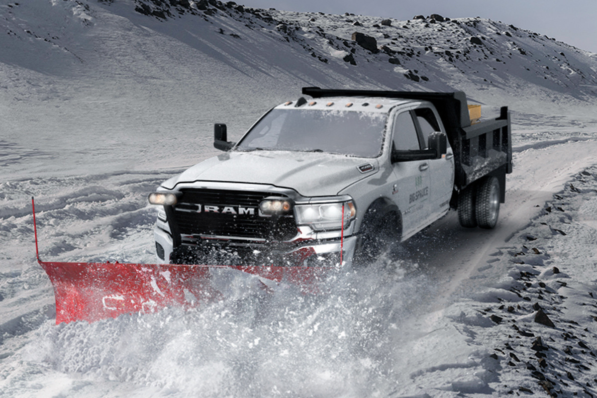 A 2019 Ram 5500 Chassis Cab with snowplow, dump upfit and salt spreader.