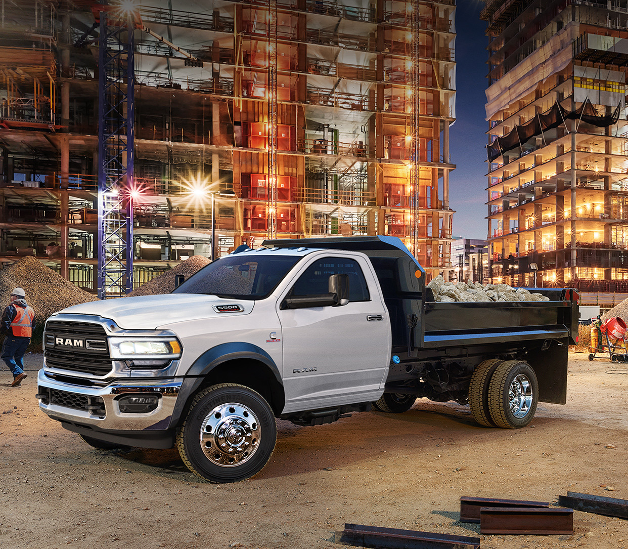 2019 Ram Chassis Cab exterior in white shown in front of a construction site.