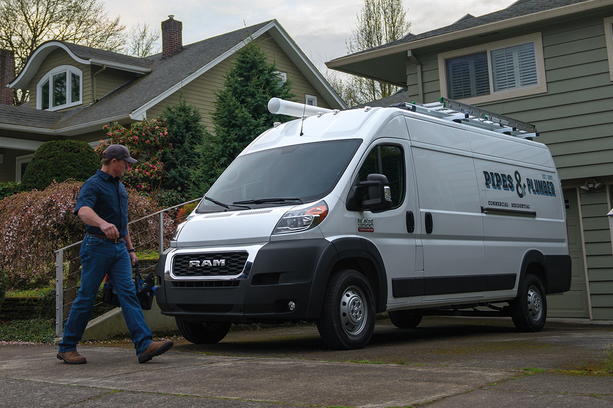 2019 Ram ProMaster parked in driveway, shown in white