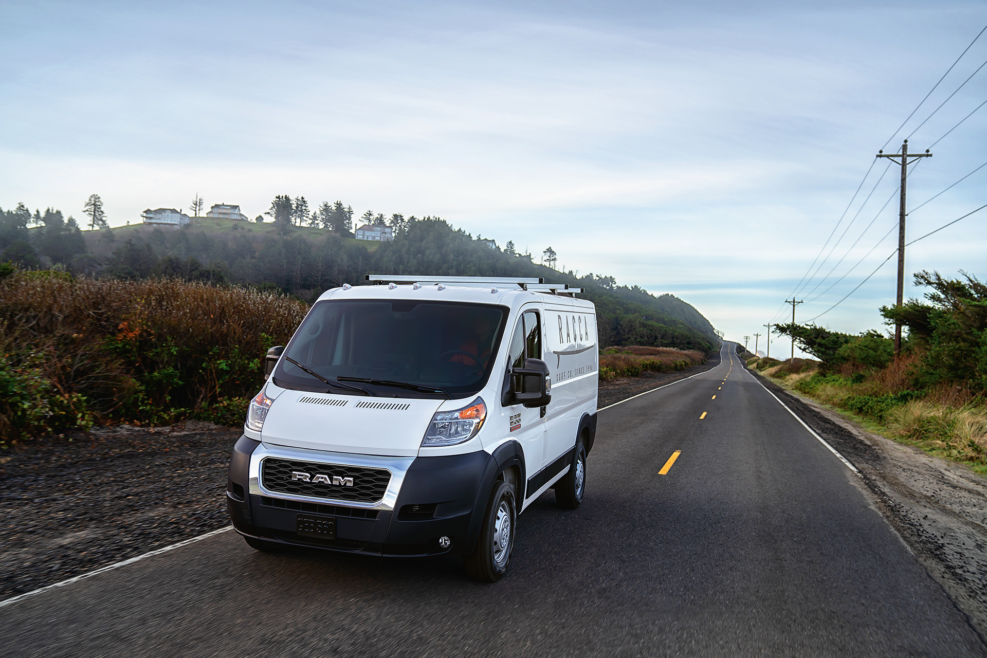 2019 Ram ProMaster driving down highway, shown in white