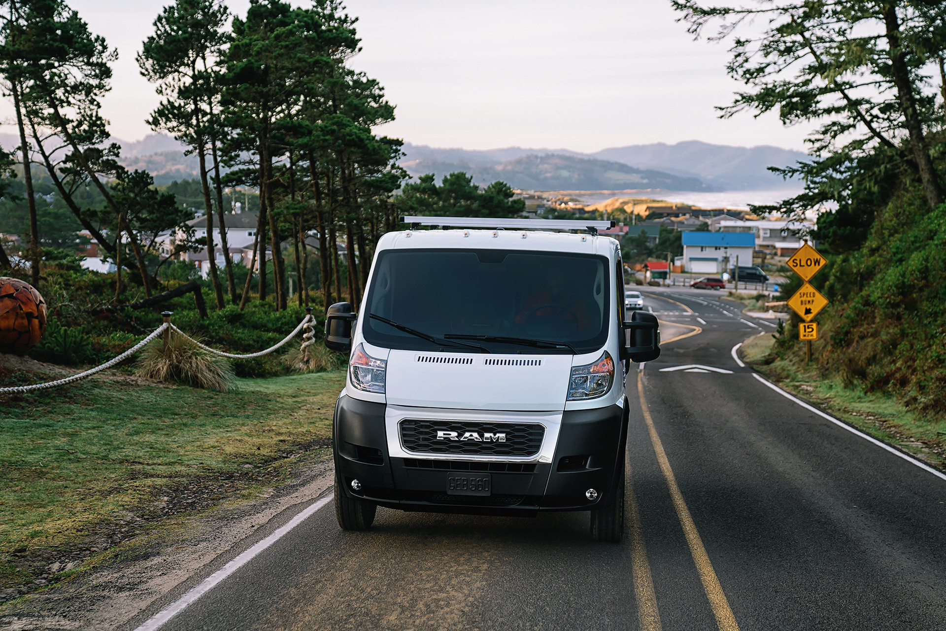 2019 Ram ProMaster front view driving down highway, shown in white