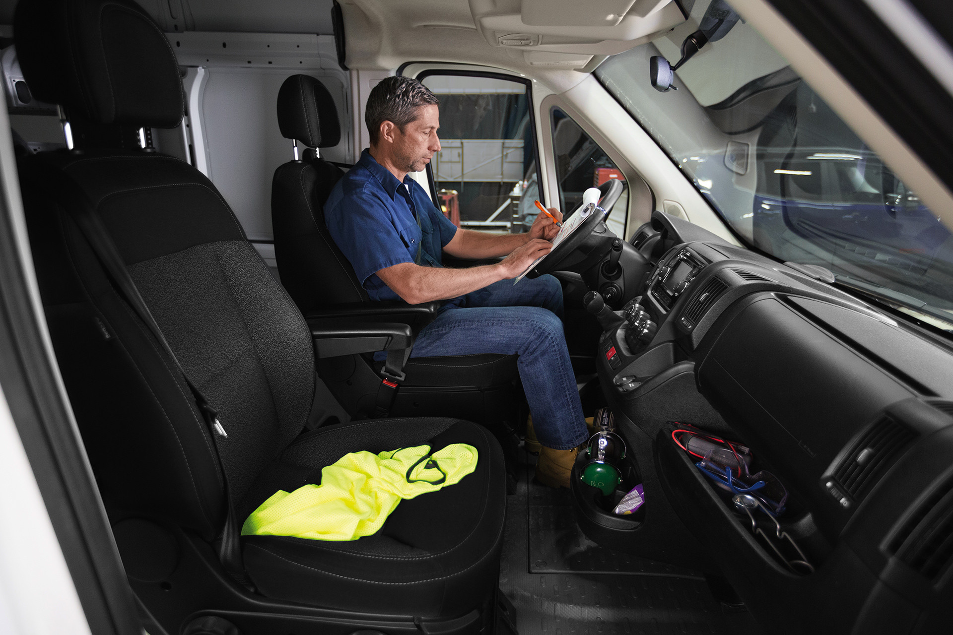 2019 Ram ProMaster interior view, showing someone driving