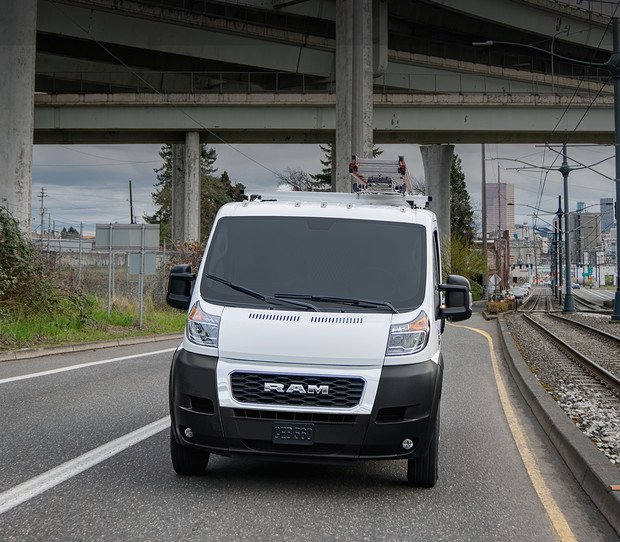 2019 Ram ProMaster front view, driving down highway, shown in white