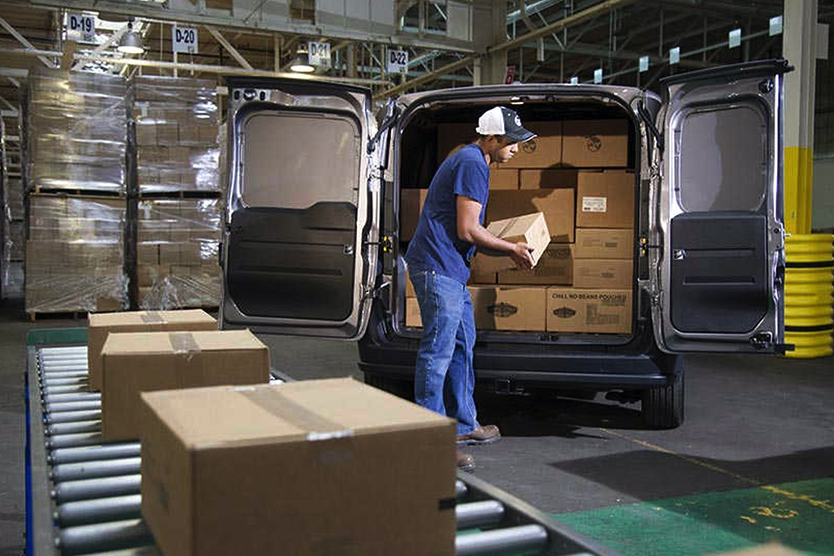 2019 Ram ProMaster City cargo doors open, being loaded by a worker