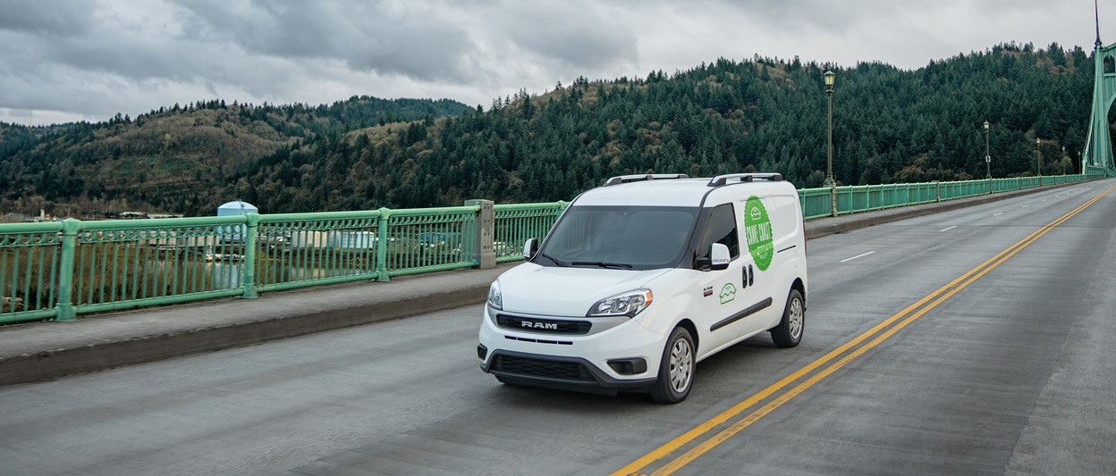 2019 Ram ProMaster City<sup>®</sup> driving over a bridge, shown in white