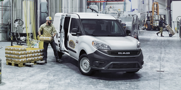 2020 Ram ProMaster City being loaded with boxes in a warehouse
