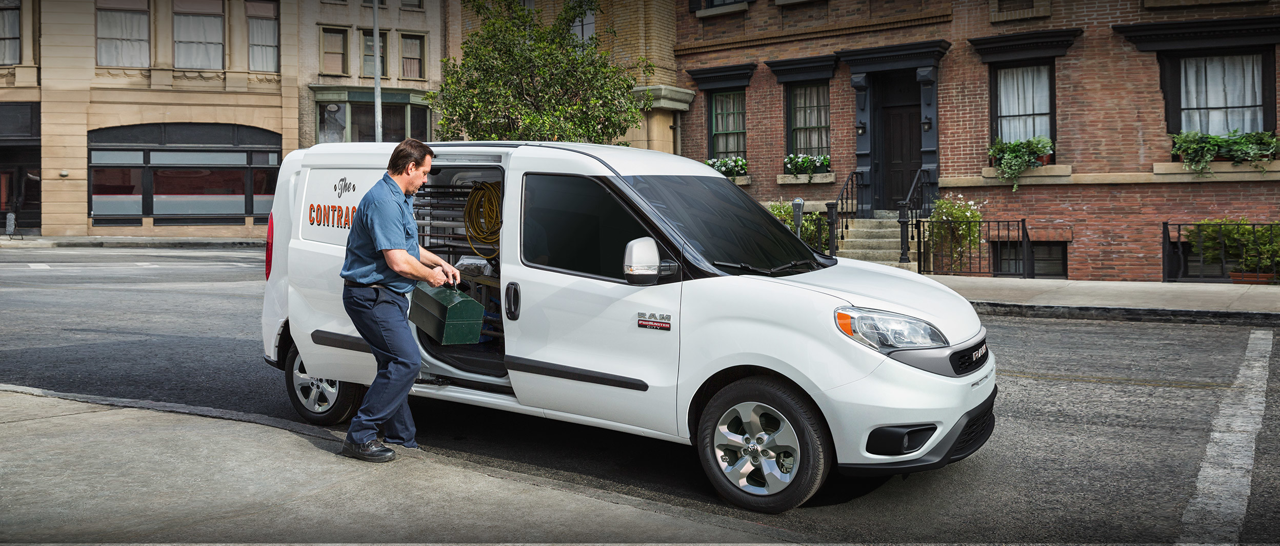 2020 Ram ProMaster City parked in urban area while man loading tool box